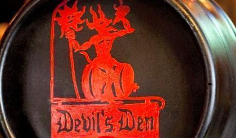 They say devil is in the details, or perhaps he hangs out at 11th and Ellsworth. Since April 2008 the Devil's Den opened to bring the best of craft and import beer and pub fare to the South Philly Neighborhood. The restaurant owners Scott and Erin Wallace, who also own Manayunk's Old Eagle Tavern, named the Devil's Den after the Gettysburg battle site- one of the bloodiest battles. A photo of the battle actually hangs above the fireplace in the restaurant.