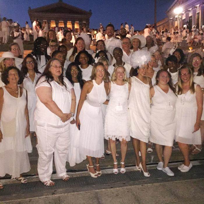 The evening takes place in a crowded public place that was not designed for such a purpose. Guests wear all white, originality is always encouraged as long as it stays stylish and denotes taste. Additionally they are responsible for bringing a table, two chairs, a white tablecloth and napkins, dinner, and wine or champagne. Press enjoyed Apothic White and Red wine from California. Additionally catering options are available, this year's catering partners for Dîner en Blanc Philadelphia included 33rd Street Hospitality Catering, Luke Palladino Catering (returning from last year), and Reading Terminal Market.