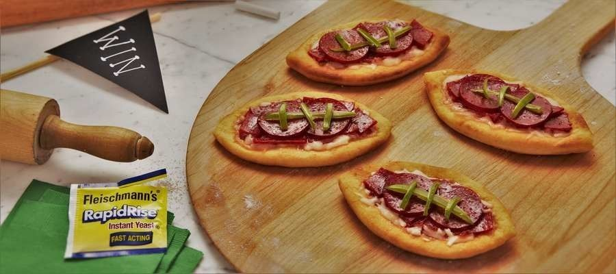 Football Pizza - Transform your favorite pepperoni pizza into a football for the next big game.
